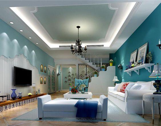 phòng khách sử dụng trần thạch cao màu xanh
